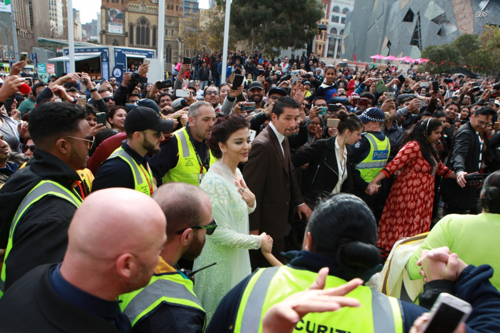 Aishwarya Rai Bachchan being escorted at IFFM 2017 flag hoisting ceremony
